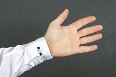Open man`s hand in a shirt royalty free stock images