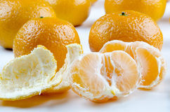 Open mandarin and some in the background Royalty Free Stock Photos