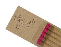 Open matchbook with message. An open matchbook with call me message and generic phone number Royalty Free Stock Image