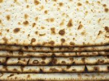 Open packing of baked matzo is laid out on the table. royalty free stock image