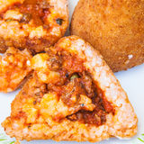 Open meat ragu stuffed rice balls arancini Stock Photo