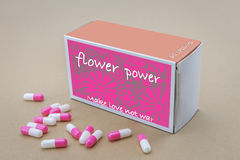 Open medicine packet labelled flower power Royalty Free Stock Photography