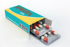 Open medicine packet labelled happiness opened Royalty Free Stock Photo