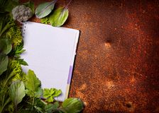 Open menu book with fresh greens Stock Photos