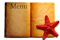Open menu book and seastar Stock Photos