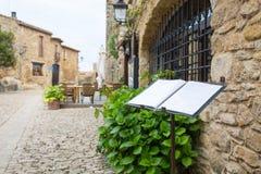 Open menu in front of a restaurant in Peratallada, Costa Brava Stock Photo