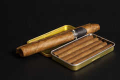 Open metal cigar box and cuban cigars Stock Images