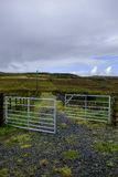 Open metal farm gate. Leading to rural countryside landscape in Isle of Skye Scotland stock image