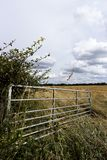 Open farm gate. Open metal framed farm gate to farmland field in rural Hampshire stock photography
