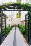 Open metal gates. Are wide open to home stock photo