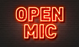 Open mic neon sign on brick wall background. Royalty Free Stock Image