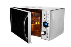 Open microwave oven. Isolated on a white background Stock Photography