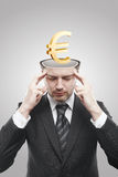 Open minded man with 3d Gold Euro Sign inside. Thinking about it. Conceptual image of a open minded man royalty free stock photo