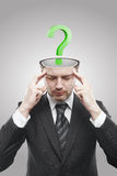 Open minded man with Green question mark inside. Conceptual image of a open minded man.On a gray background stock photography