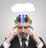 Open minded man with Social people inside. People with social chat sign and speech bubbles. Thinking man representing a social network. Conceptual image of a royalty free stock image
