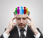 Open minded man with Social people inside. Thinking man representing a social network. Conceptual image of a open minded man.On a gray background stock photos