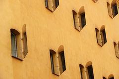 Open mirror shutters on the sunlit wall of the house, Stockholm Royalty Free Stock Photo