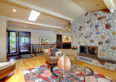 Open Modern Luxury Home Interior Living Room And Stone Fireplace. Stock Image
