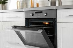 Open modern oven. Built in kitchen furniture royalty free stock images