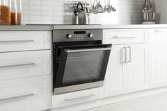Open modern oven built. In kitchen furniture royalty free stock photos