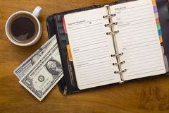 Open daily, money and cup of coffee Royalty Free Stock Photography