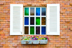 Open mosaic window on brick wall Royalty Free Stock Photography