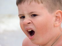 Open mouth. The little boy has opened a mouth and yawns Royalty Free Stock Images