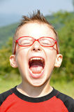 Open mouth children. Red glasses, open mouth children Royalty Free Stock Image