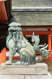 Open mouth lion at itsukushima Shinto Shrine. Royalty Free Stock Photo