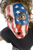 Open-mouthed fan. Face of young male sport's fan with Old Glory painted on face.  Wide angle view Stock Photo