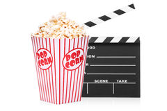 Open movie clap and popcorn box. A studio shot of an open movie clap and popcorn box isolated on white background Royalty Free Stock Photo