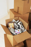 Open Moving Box With Cup And Frame Inside Stock Image