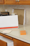 Open Moving Box on Kitchen Counter Royalty Free Stock Photography