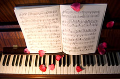 Open music on the piano Royalty Free Stock Photo