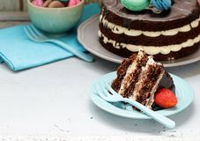 Open naked chocolate cake with vanilla cream Stock Photos