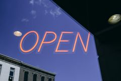 An open neon business sign Stock Images