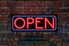 Open Neon Sign on Brick wall Stock Photos