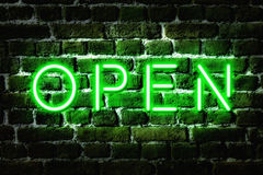 Open Neon Sign. Open green neon sign on brick wall Stock Image