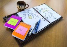 Open notaboek op een lijst Stock Afbeeldingen
