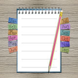 Open note book with bookmark and pencil Stock Photography