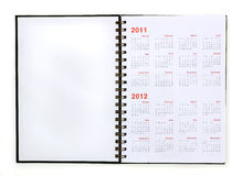 Open note book with calendar 2011, 2012. On white Royalty Free Stock Photography
