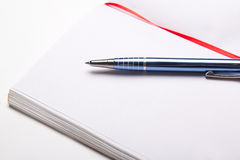 Open note book with copy space on pages with pen Royalty Free Stock Photo