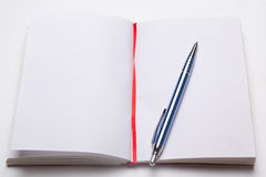 Open note book with empty pages with pen Stock Photo