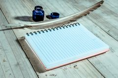 Open note book with feather pen,filter effect.  Royalty Free Stock Image