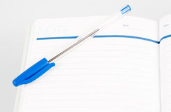 Open note book with lined pages free date space and ballpoint pe Stock Photo