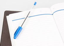 Open note book with lined pages free date space and ballpoint pe Royalty Free Stock Photography