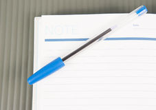 Open note book with lined pages free date space and ballpoint pe Royalty Free Stock Images