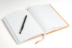 Open a note book and pen Royalty Free Stock Photos