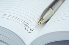 Open note book with pen. On white Royalty Free Stock Images