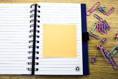 Open note book with stickies on wooden background Stock Images